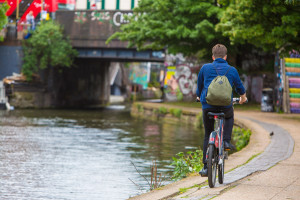 Boy cycling by canal